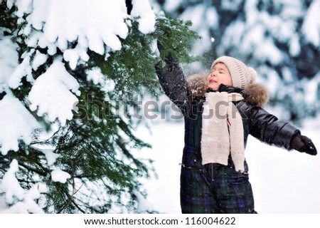 happy child in a beautiful snowy forest