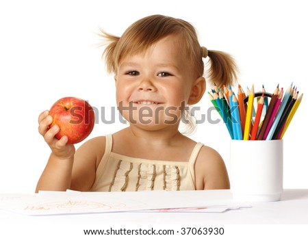 Happy child in preschool, play with color pencils and smile, isolated over white - stock photo