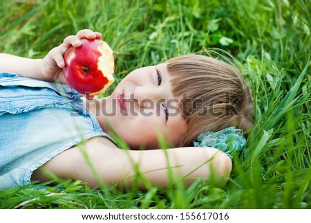 Happy Child in Summer.  Beautiful Girl with Red Apple in the Garden. Happy Children. Healthy Kids. Spring Time. Vacation in the Countryside.