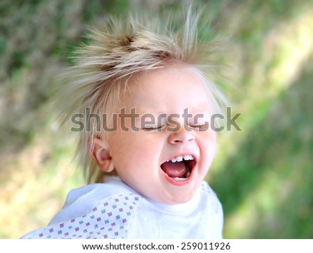 Happy Child in the Summer Park - stock photo