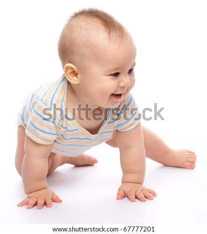 Happy child is crawling on floor and smile, isolated over white - stock photo