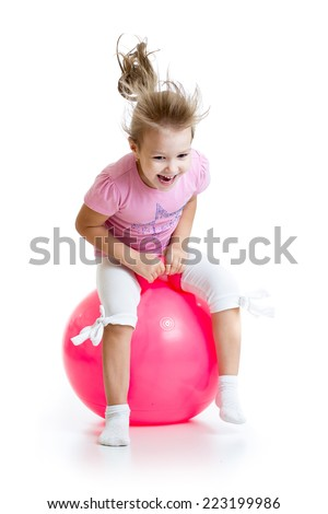 happy child jumping on bouncing ball. Isolated on white. - stock photo