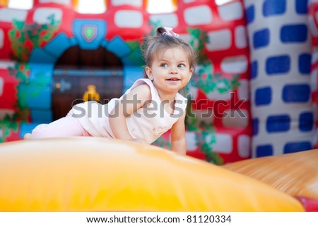 Happy child jumping on trampoline outdoors