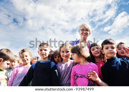 happy child kids group have fun and play at kindergarden preschool education concept with  teacher - stock photo
