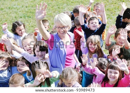 happy child kids group have fun and play at kindergarden preschool education concept with  teacher