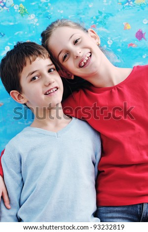 happy child kids portrait at home brother and sister hug and have fun and joy - stock photo