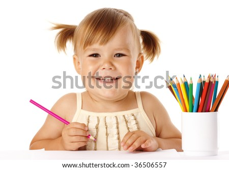 Happy child play with colorful crayons and smile, isolated over white - stock photo