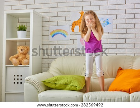 happy child playing in the room - stock photo