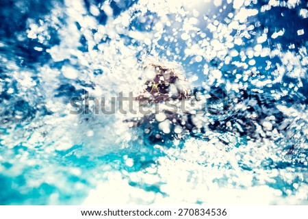 Happy child playing in the sea. Water splash. Blurred background. Summer vacation concept - stock photo