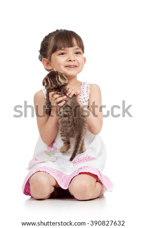 happy child playing with cat kitten