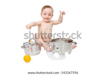 Happy child playing with pans and oranges isolated on white background - stock photo