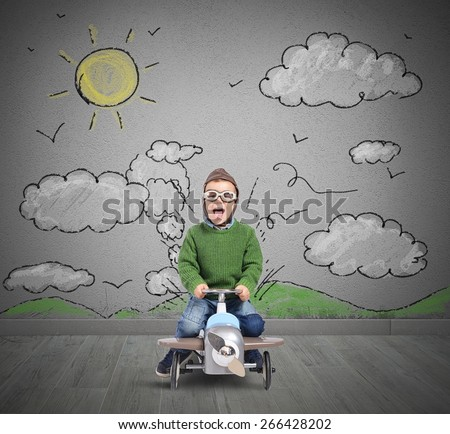 Happy child plays with his car airplane - stock photo