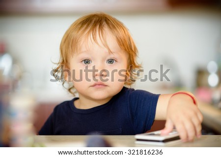 Happy child portrait in the kitchen. Breakfast, lunch or dinner with family