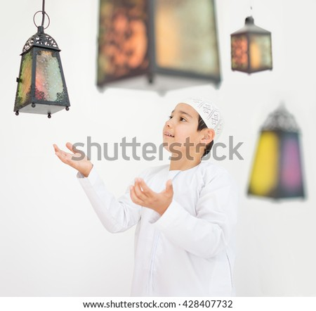 Happy child ready for Ramadan with lantern