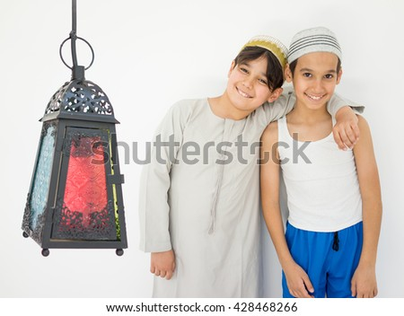 Happy child ready for Ramadan with lantern - stock photo