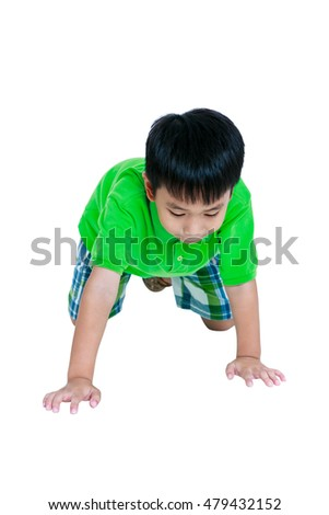 Happy child smiling and crawling on knees. Stylish asian boy having fun at studio. Isolated on white background. Studio shot. Positive human emotion.