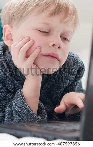 Happy child using a modern laptop - stock photo