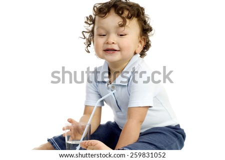 Happy child with a glass of water,isolated on a white background. - stock photo