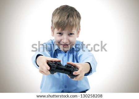 Happy child with a joystick for game console