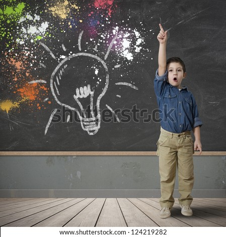 Happy child with a new idea - stock photo