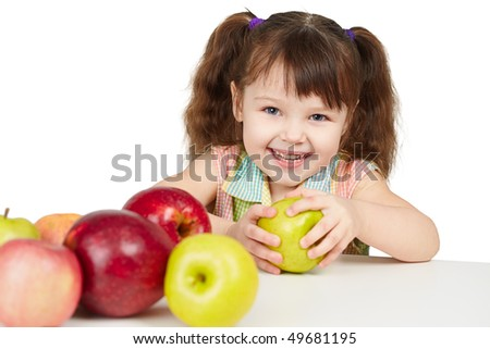 Happy child with apples - sources of vitamins on white background - stock photo