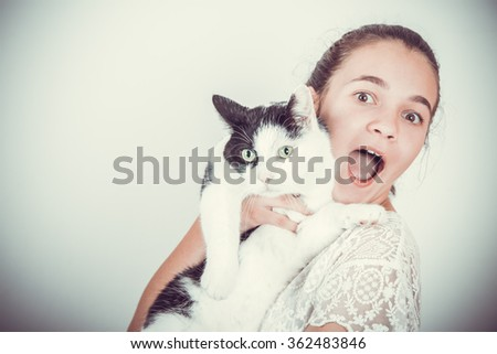 happy child with cat in her arms