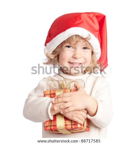 Happy child with Christmas gift isolated on white background - stock photo