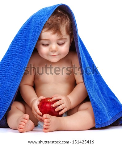 Happy child with fresh fruit isolated on white background, cute baby boy covered with blue towel, happy and healthy lifestyle, toddler pampering, baby nutrition concept - stock photo