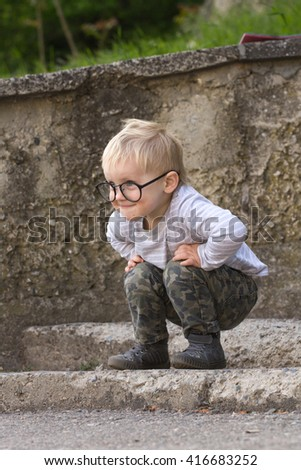 Happy child with  glasses having fun, outdoors - stock photo