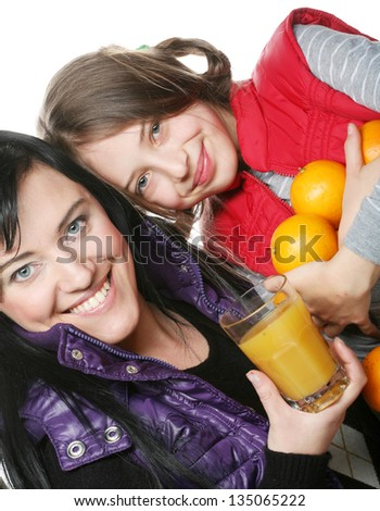 happy child with mother holding oranges and juice - stock photo