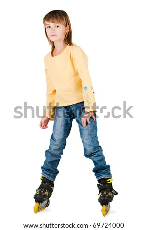 Happy childhood. Driving on roller skates. - stock photo