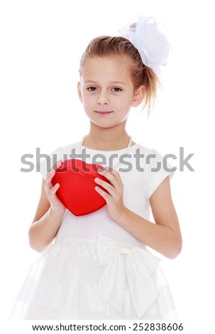 Happy childhood, the family concept.Beautiful caucasian girl holding a box in the chest in the form of heart. Isolated on white. - stock photo