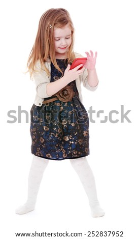 Happy childhood, the family concept.Cute cheerful girl sees the mobile phone screen.Isolated on white. - stock photo
