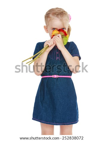 Happy childhood, the family concept.Cute little girl smelling a bouquet of flowers.Isolated on white. - stock photo