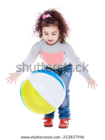 Happy childhood, the family concept.Happy joyful little girl playing with a ball.Isolated on white. - stock photo