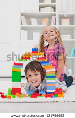 Happy children among the blocks - focus on the boy