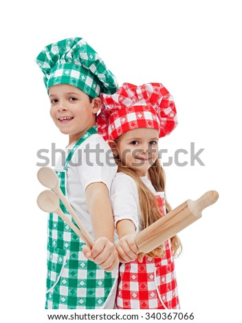 Happy children chefs with wooden utensils smiling - isolated - stock photo