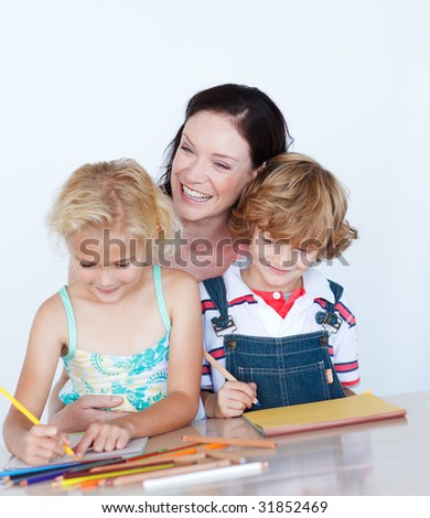 Happy children doing homework with their mother - stock photo