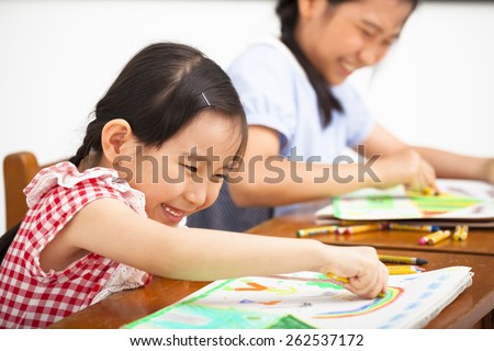 happy children drawing in the classroom - stock photo
