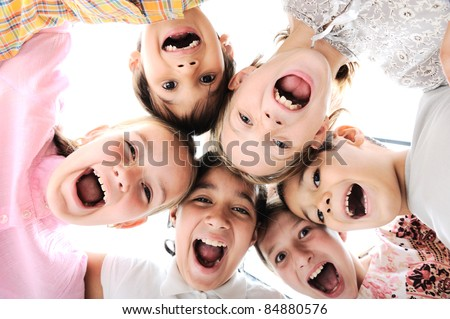 Happy children embracing each other and smiling at camera - stock photo