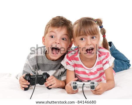 Happy children - girl and boy playing a video game - stock photo