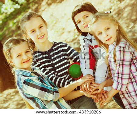Happy  children holding hands and giving friendship swear - stock photo