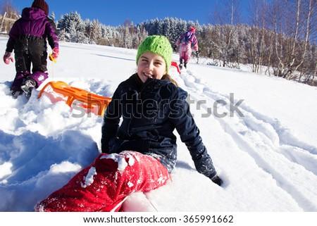 Happy children in winter. Children playing on the snow. Children sledging - stock photo