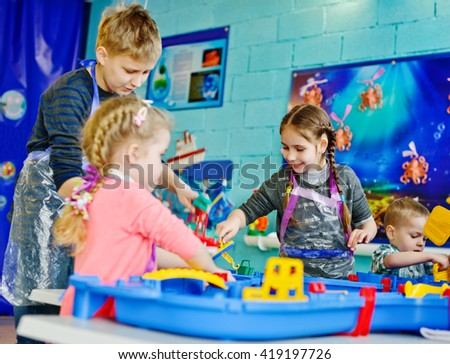 happy children is playing big water toy