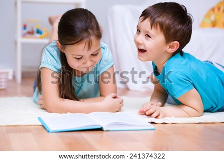Happy children is reading book - stock photo