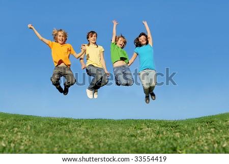 happy children jumping - stock photo