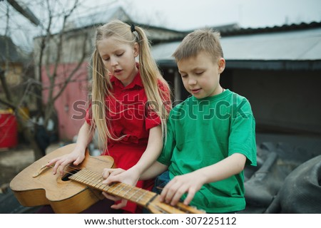 happy children learn to play the guitar