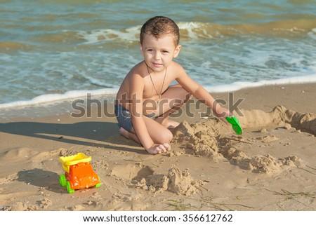 Happy Children - little boy having fun on the beach. Positive human emotions. - stock photo