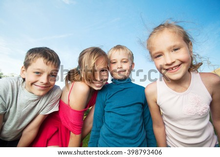 Happy children outdoors. Friends at summer