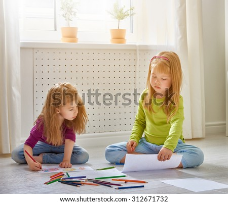 happy children paint together